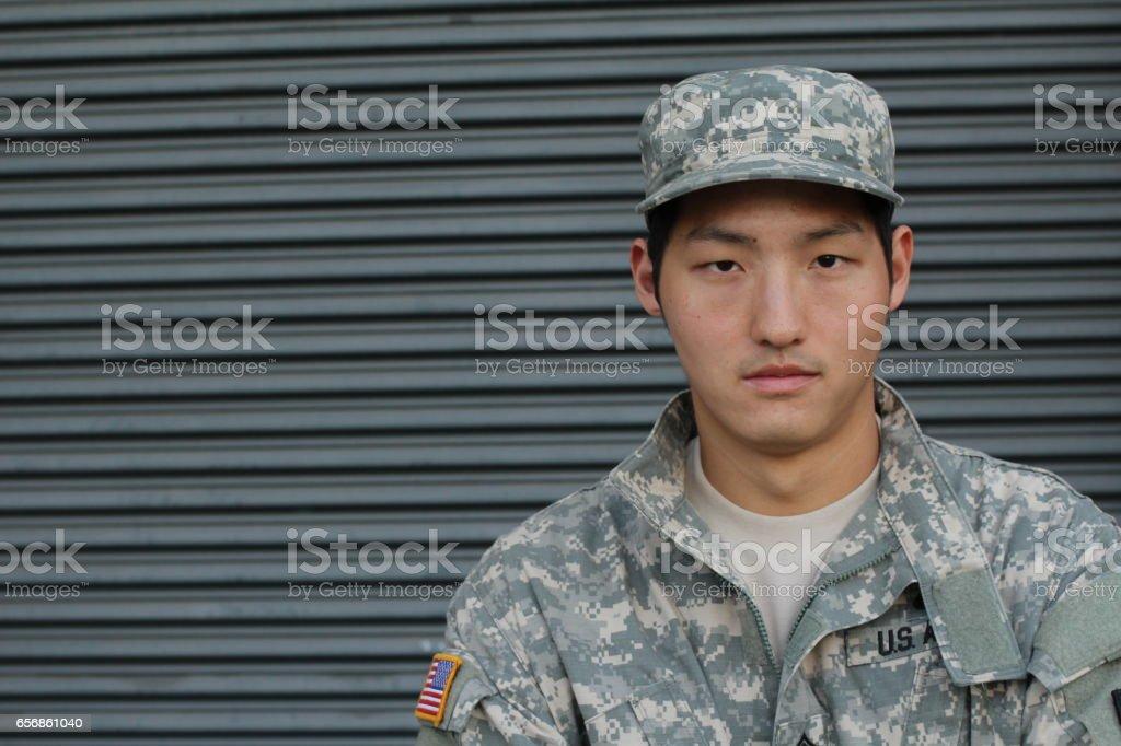 Military young Asian man. Studio portrait stock photo