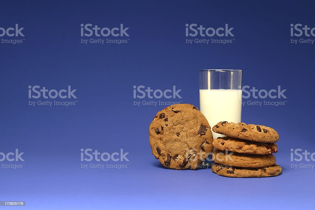 Milk and Cookies on Blue royalty-free stock photo