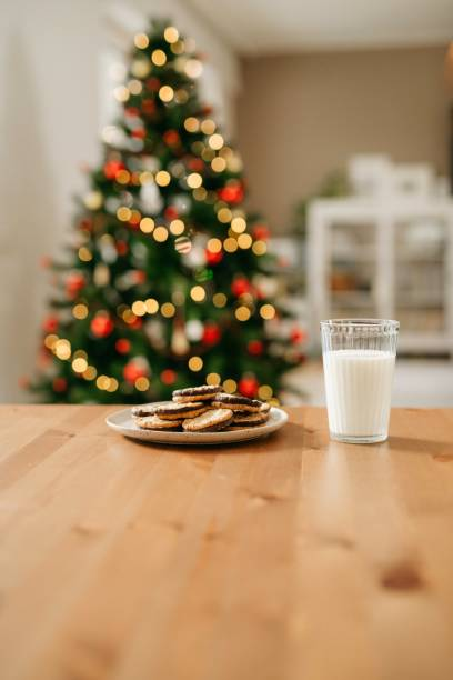 Milk and cookies on the table stock photo