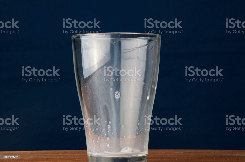 Milk and empty glass. Wooden table foto royalty-free