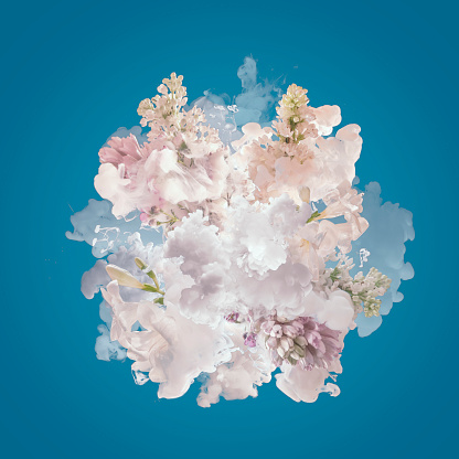 istock Milk and flowers exploding 941333624