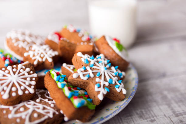 milk and gingerbread cookies decorated with icing - christmas cookies stock pictures, royalty-free photos & images