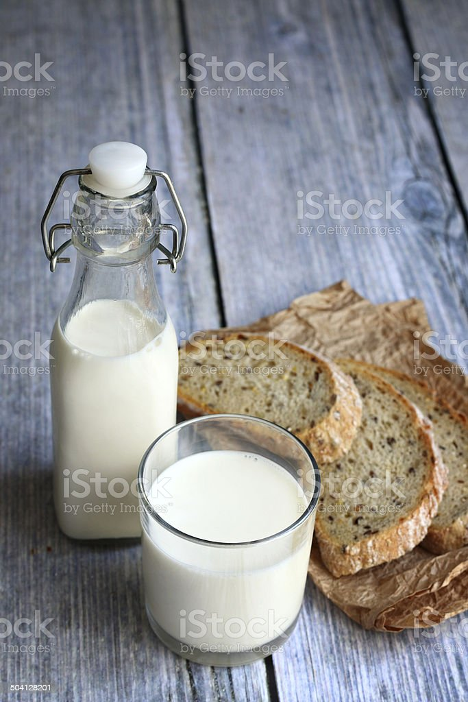 Milk and wholegrain bread stock photo