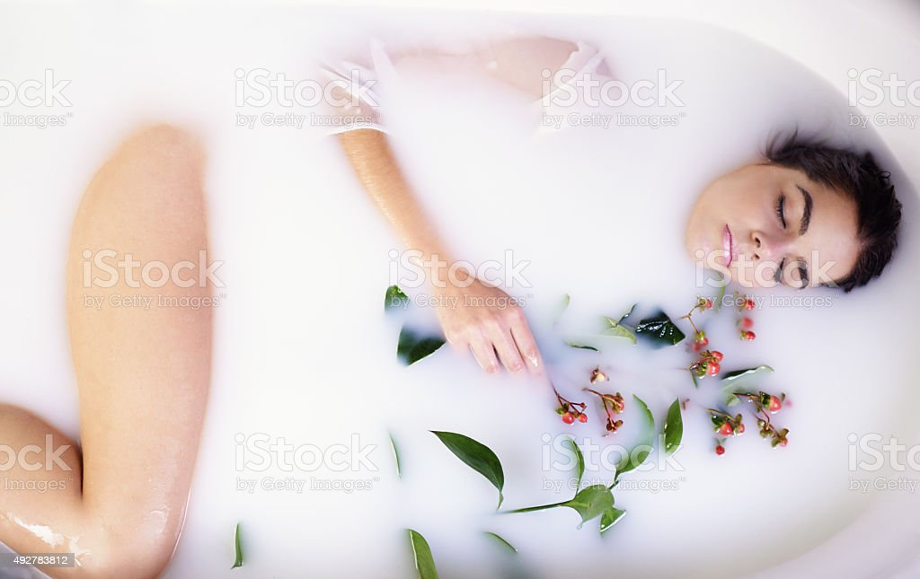 Milk baths leave you skin feeling soft, refreshed and moisturized stock photo