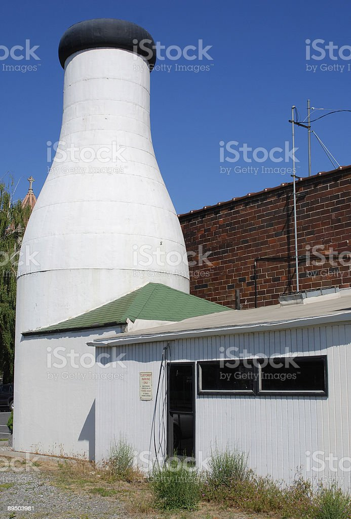 Milk bottle building royalty-free stock photo