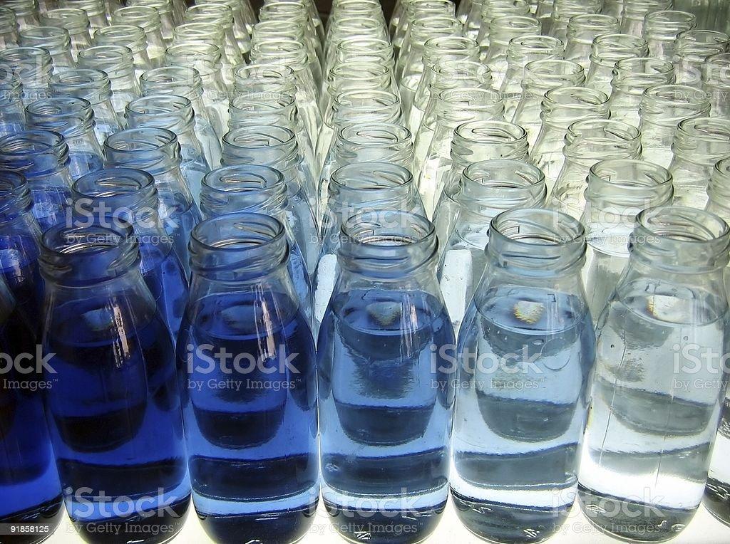Milk Bottle Line-Up royalty-free stock photo
