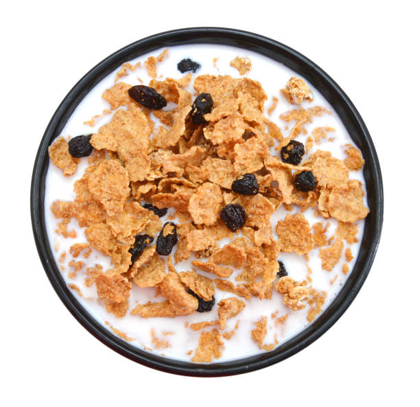 milk bran and raisin cereal in a bowl , top view stock photo