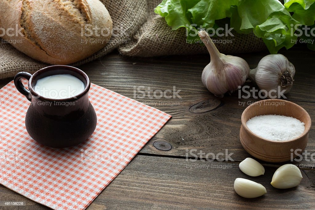 milk, bread , garlic and lettuce stock photo