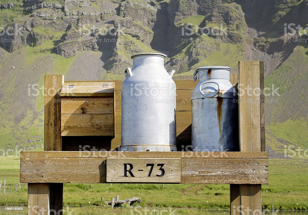 milk canisters and wooden mailbox stock photo