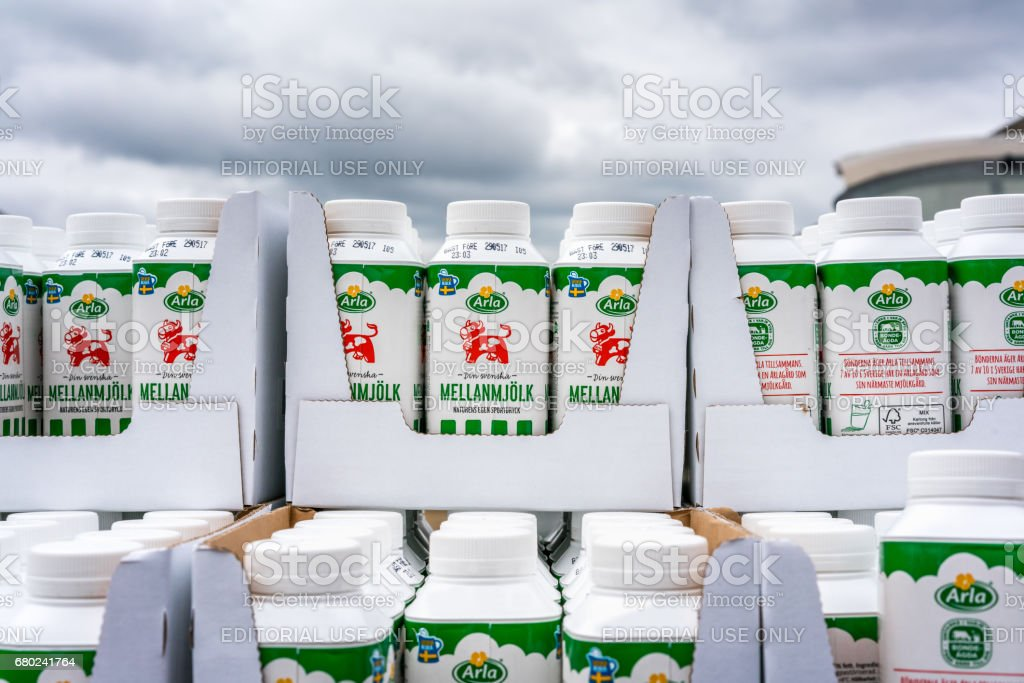 Milk cartons stacked outdoors. stock photo