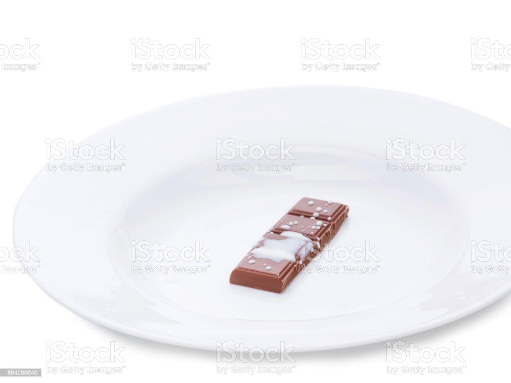 Milk chocolate falling into milk. Milk splash, isolated over white royalty-free stock photo