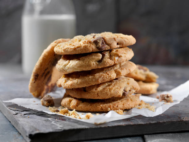 Milk Chocolate, Macadamia Nut Cookies and Milk Milk Chocolate, Macadamia Nut Cookies and Milk chocolate chip cookie stock pictures, royalty-free photos & images