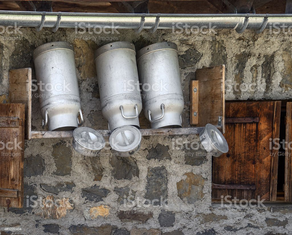 Milk churns at a mountain hut stock photo