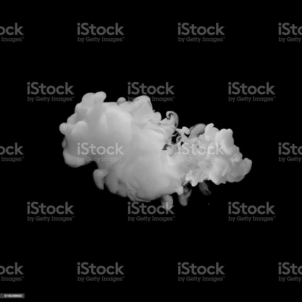 milk cloud at black background stock photo