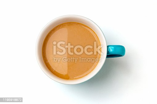 Milk coffee in blue ceramic mug on white background