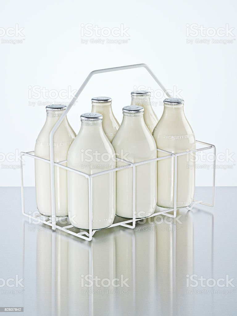 Milk holder with milk bottles foto stock royalty-free