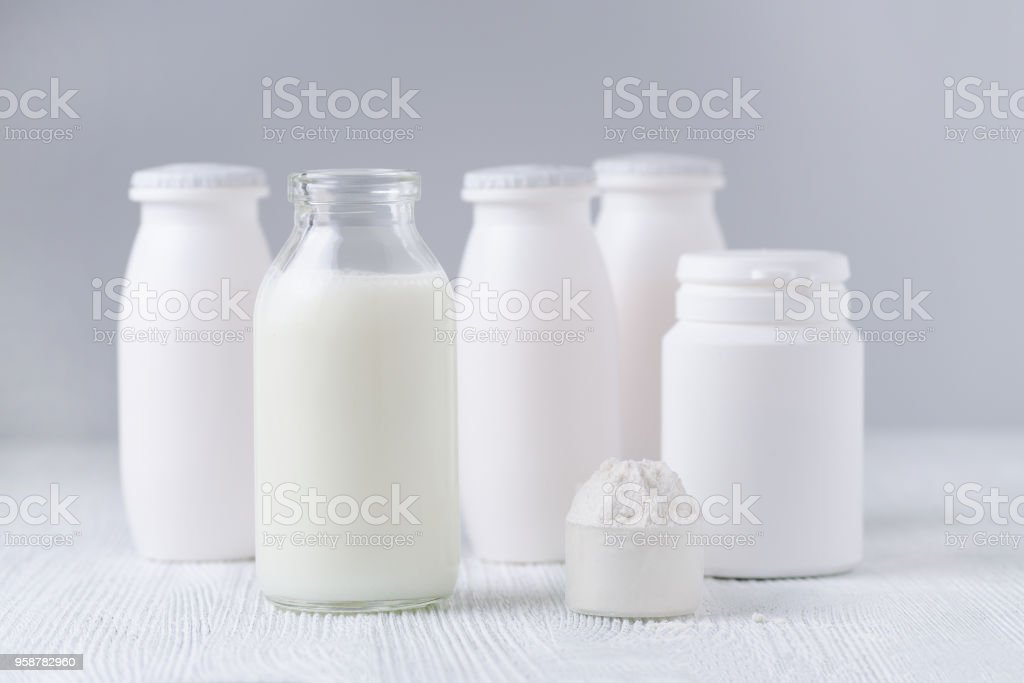 milk products, drink yogurt and white powder on the table