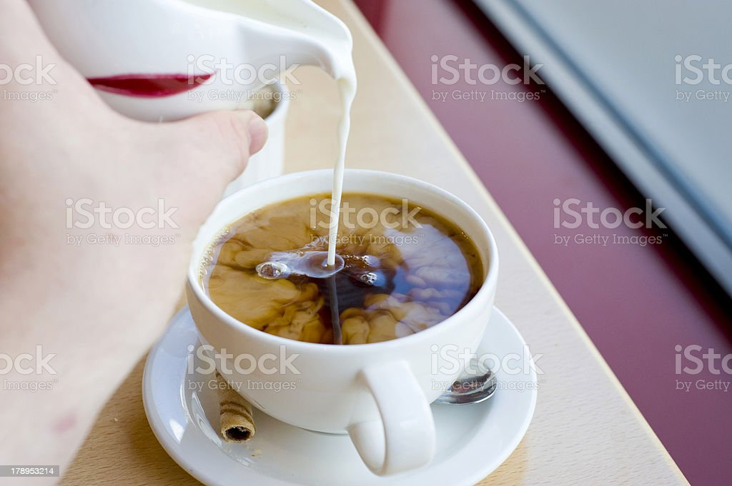 Milk in Coffee royalty-free stock photo