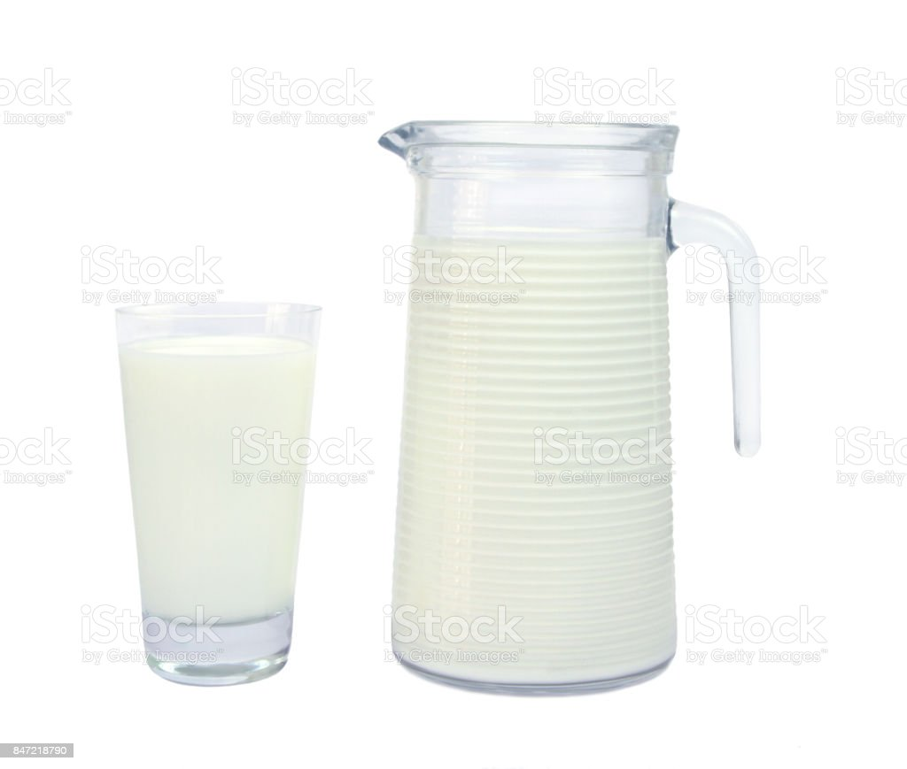 Milk in glass and carafe stock photo