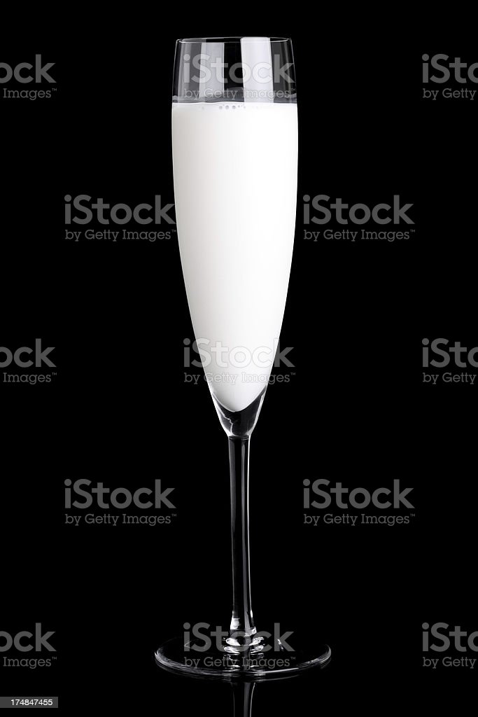 Milk in glass of Champagne royalty-free stock photo