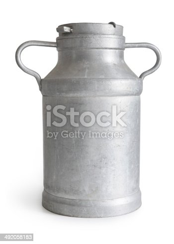 Old milk jug on white background.