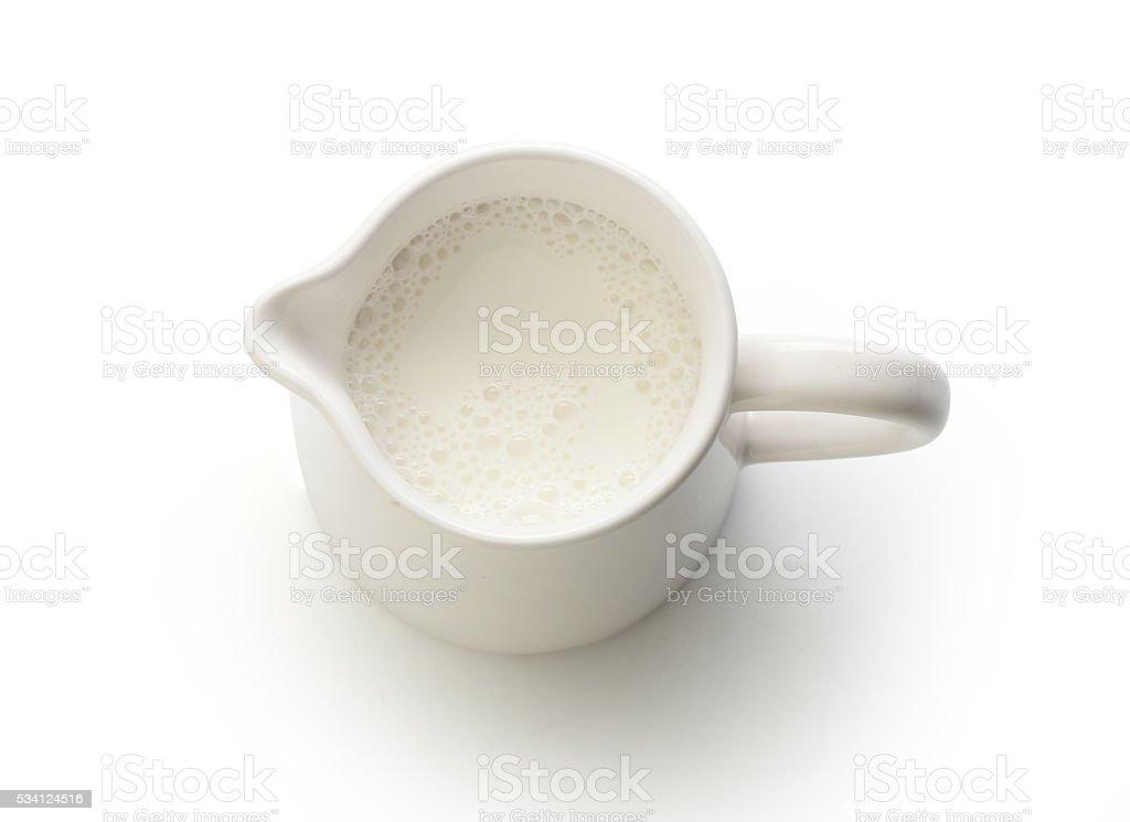 Milk jug with milk stock photo