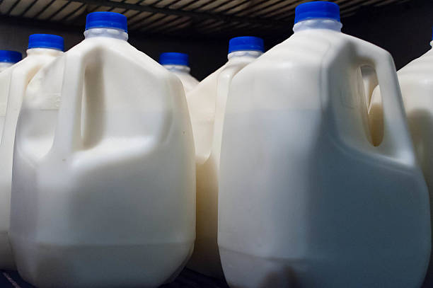 Milk Jugs Jugs of raw milk at the local farm. gallon stock pictures, royalty-free photos & images
