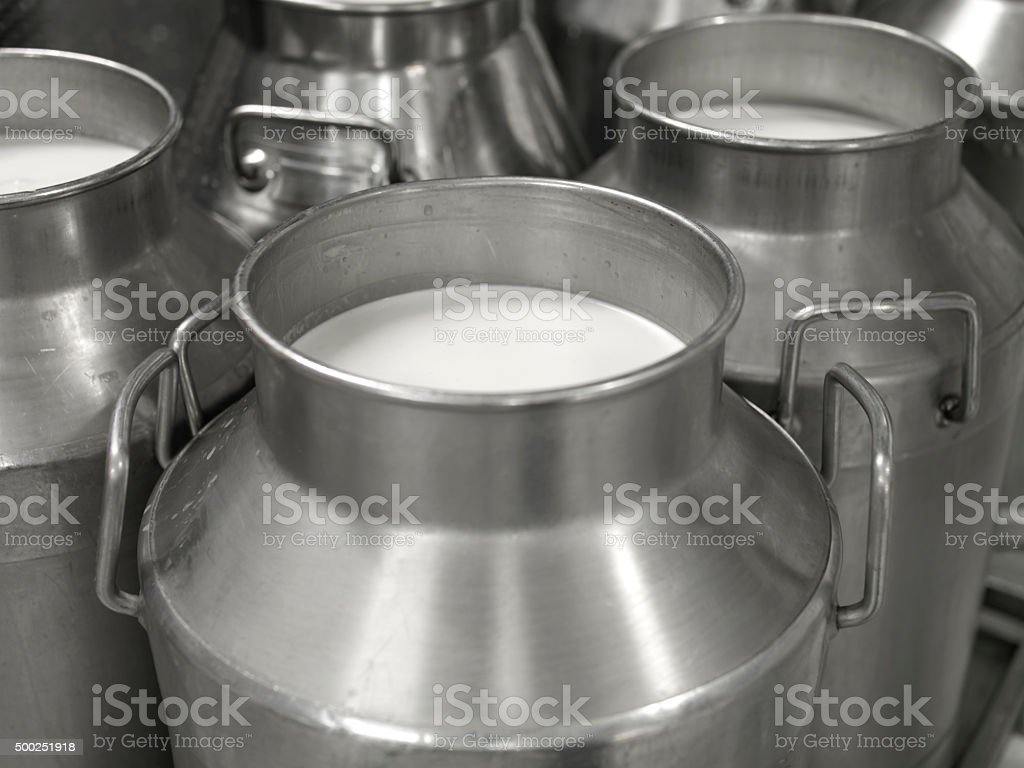 milk jugs stock photo