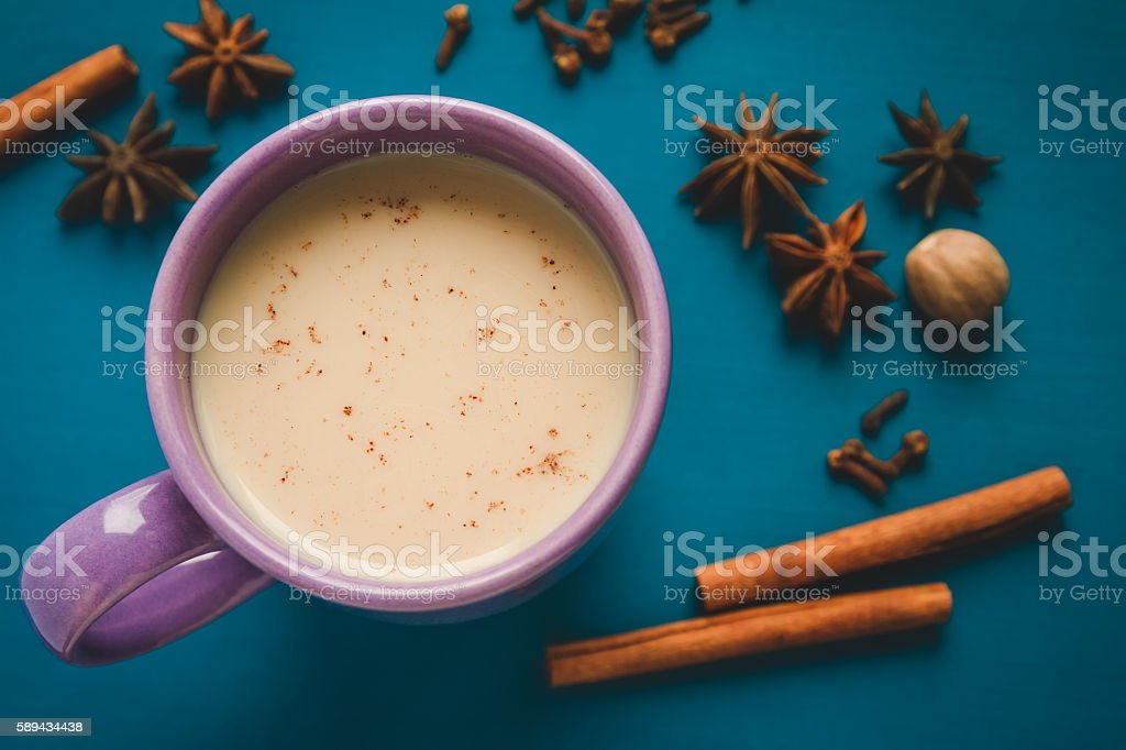milk masals tea with different spices on the table stock photo