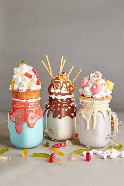 milk monster shakes or freak shake - big cake stock photos and pictures