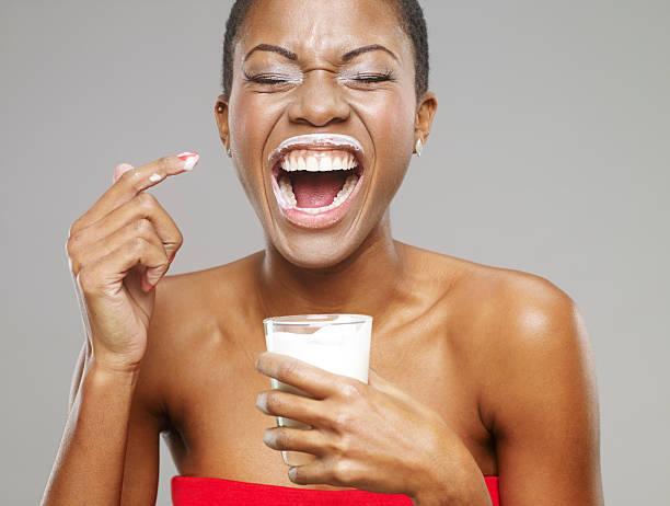 Milk Moustache On Beautiful African-American Woman stock photo