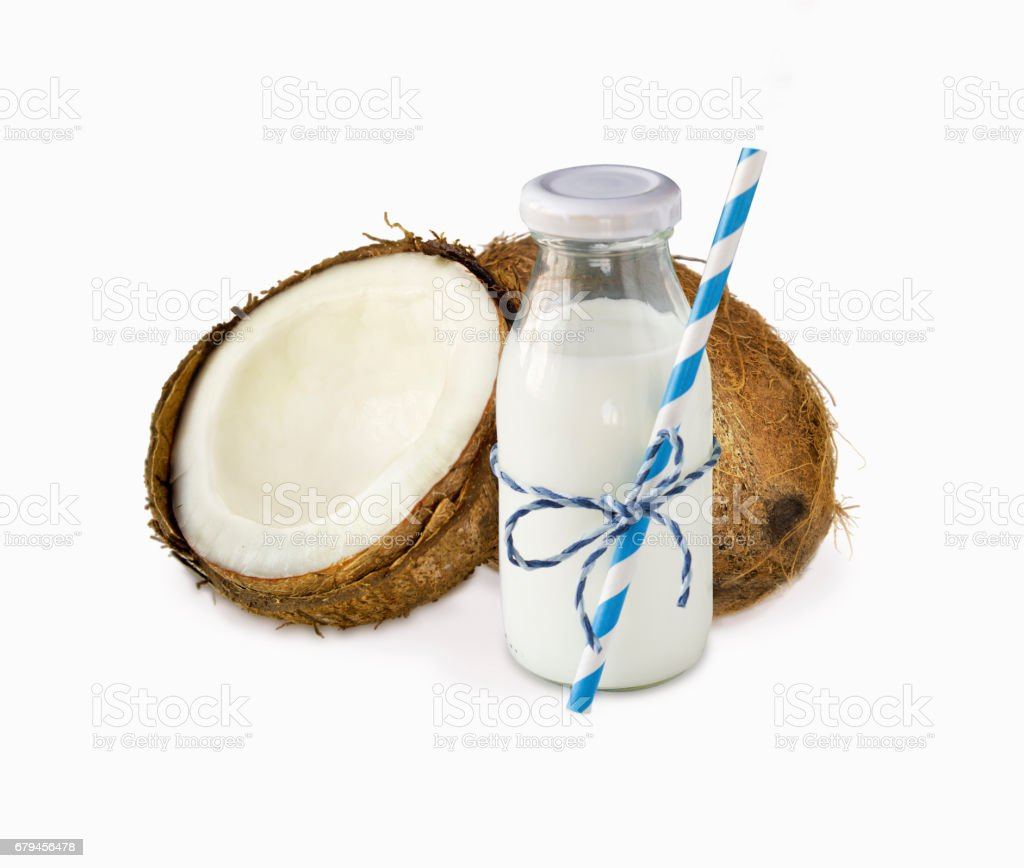 milk of coconut and fresh coconuts isolated on white background. royalty-free stock photo