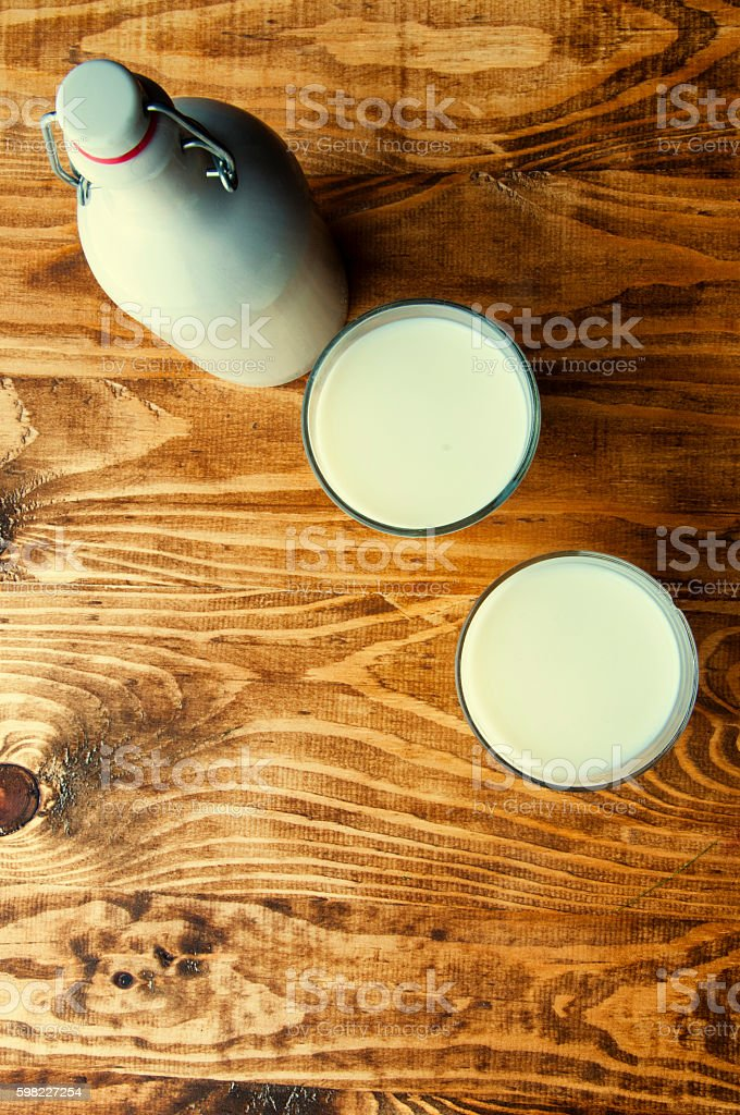 Milk on a wooden table foto royalty-free