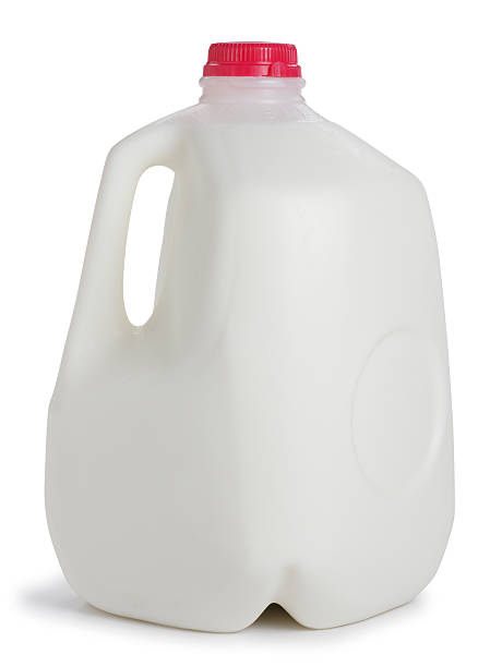 Milk A one gallon container of milk. gallon stock pictures, royalty-free photos & images