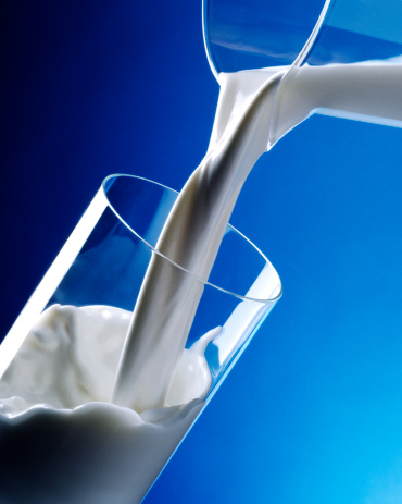 Milk Pouring Into Glass Stock Photo - Download Image Now ...