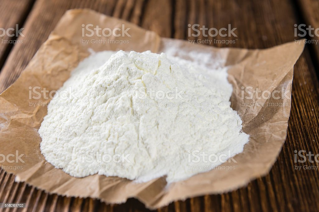 Milk Powder on an old vintage wooden table