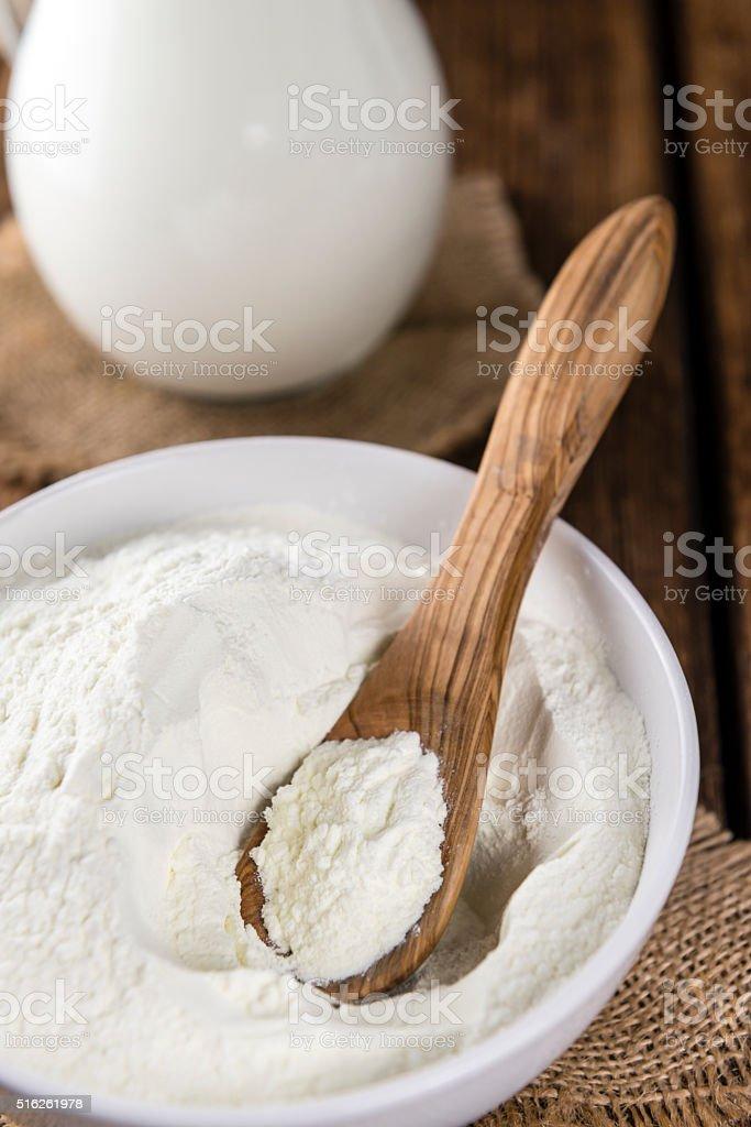 Portion of Milk Powder on wooden background