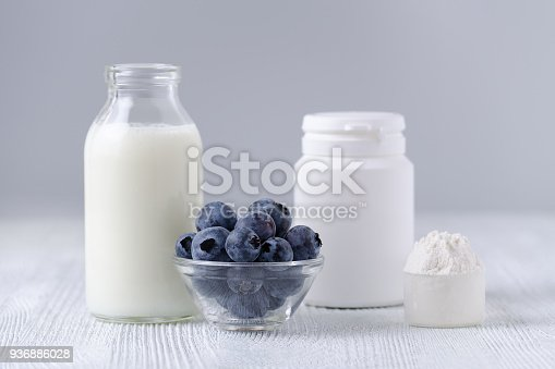 istock milk products and blueberrys on the table 936886028