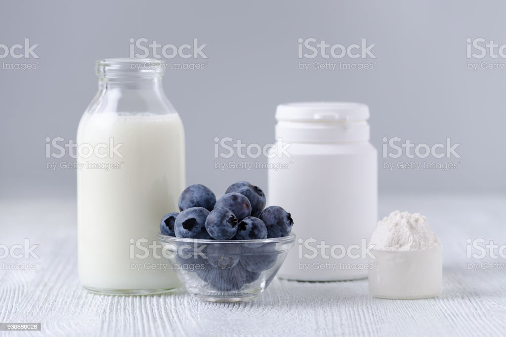 milk products and blueberrys on the table stock photo