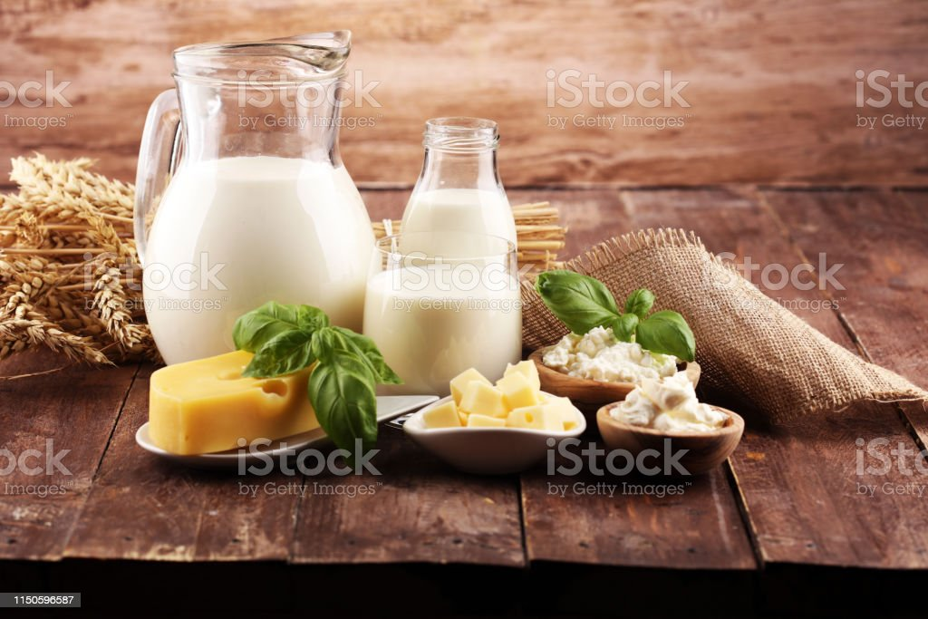 milk products. tasty healthy dairy products on a table and milk jar,...