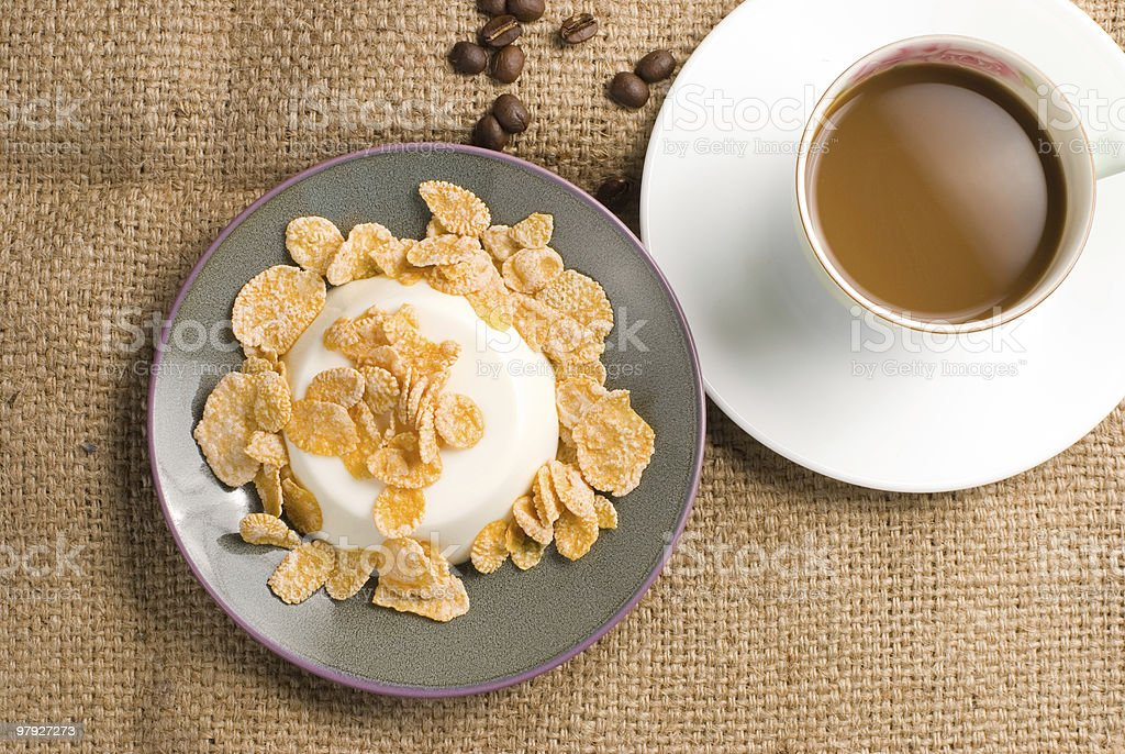 Milk pudding with sweet crisps and coffee royalty-free stock photo