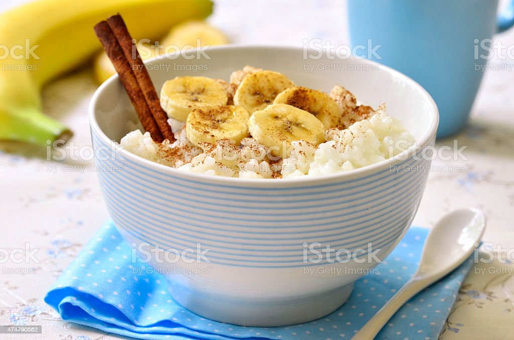 Milk rice porridge with banana,cinnamon and honey. stock photo