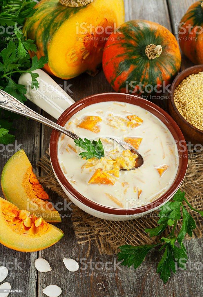 Milk soup with pumpkin and millet Lizenzfreies stock-foto