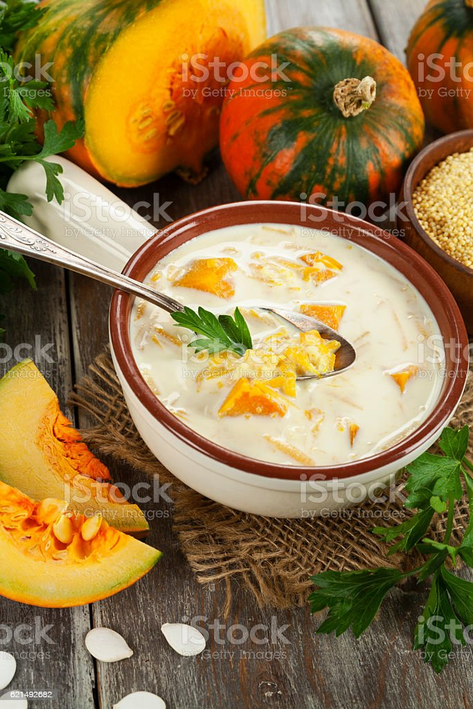 Milk soup with pumpkin and millet photo libre de droits