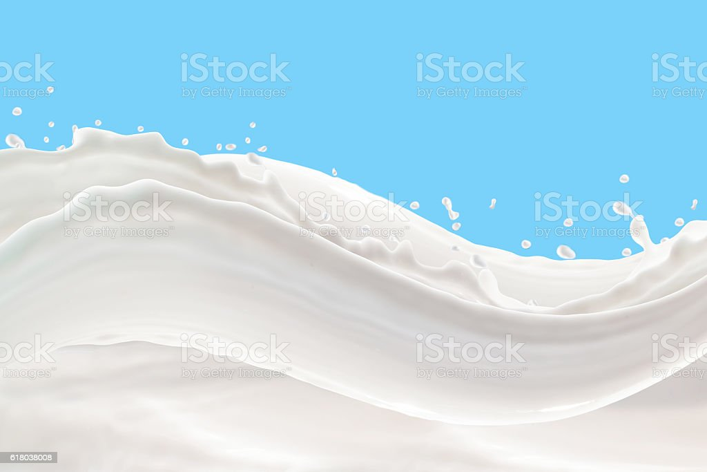 Milk Splash On blue backgroundMilk Splash On blue background stock photo