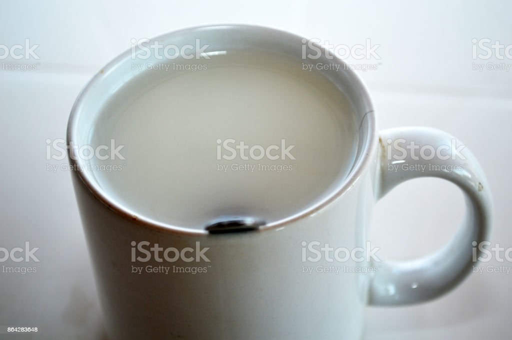 Milk tea in a white cup royalty-free stock photo
