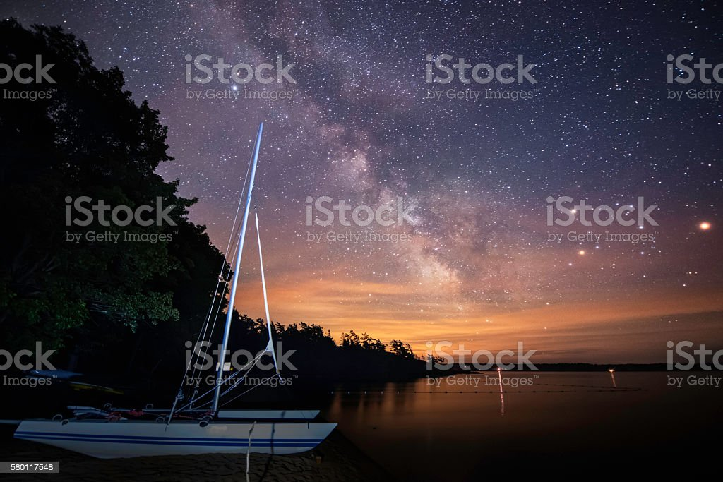 Milk way and boat stock photo