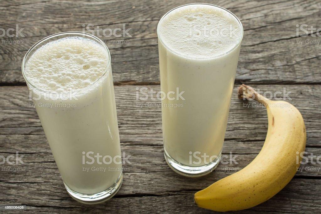 Milk with banana stock photo