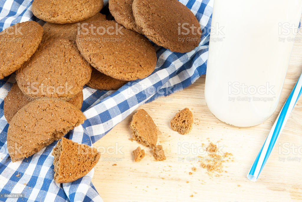 Milk with straw and oatmeal cookies royalty-free stock photo