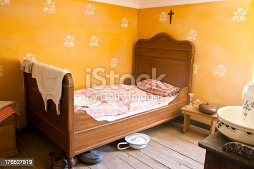 Simple bedroom of a maid in southern Tyrol. Relics abject poverty in Southern Tyrol where the people still live like hundred years ago.
